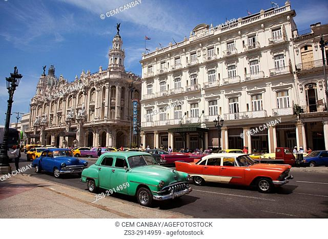 Vintage American car used as taxi in Central Havana with the Hotel Inglaterra, Gran Teatro and Capitolio building at the background, La Habana, Cuba