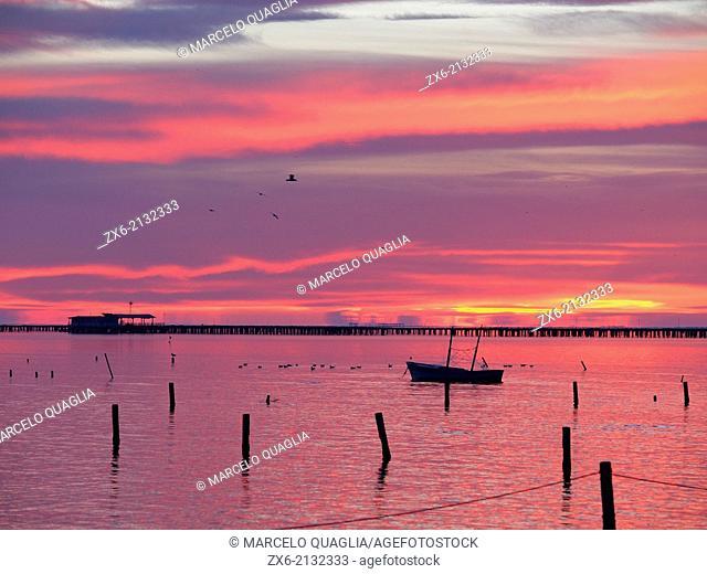 Alfacs Bay at dawn with mussel breeding nurseries. Ebro River Delta Natural Park, Tarragona province, Catalonia, Spain