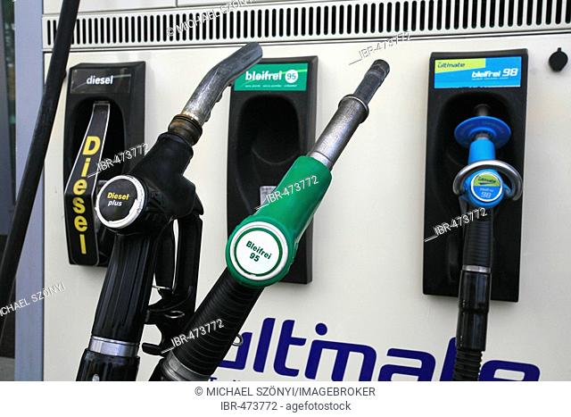 Fuel nozzles at a gas station with Diesel and Unleaded Fuel