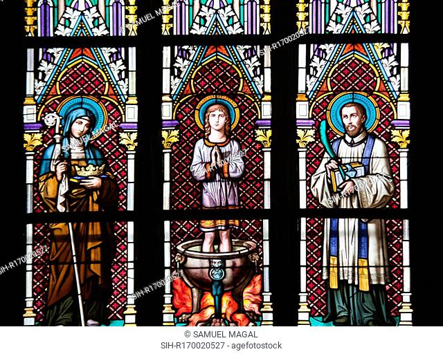 Stained Glass Window depicting, from left to right, St. Agnes of Bohemia, St. Vitus and St. Sarcander