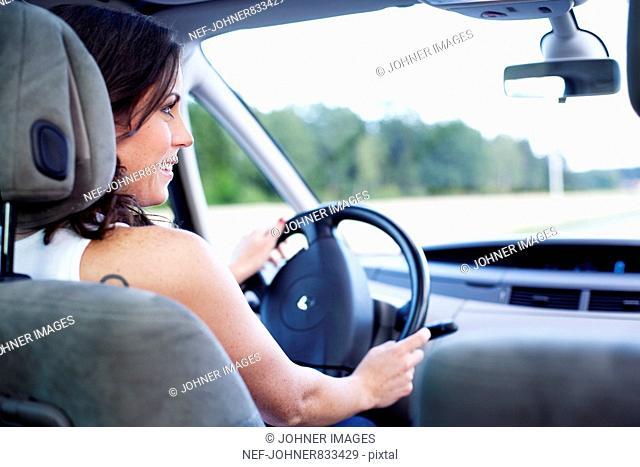 Woman driving a car, Sweden