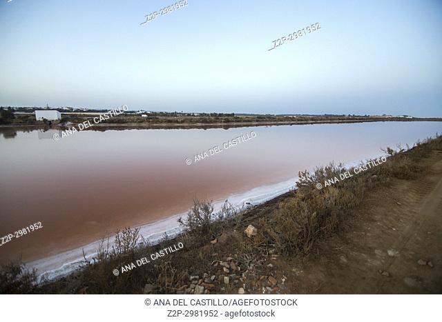 Sunset in Tavira salt ponds Algarve Portugal