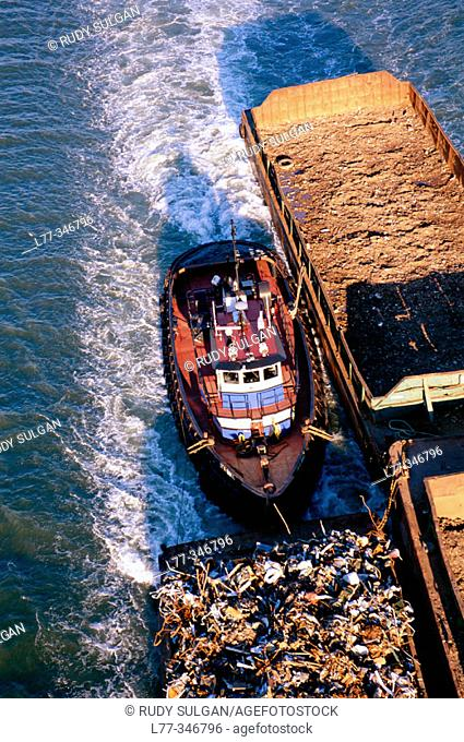 Tugboat and barges on East River, New York City. USA