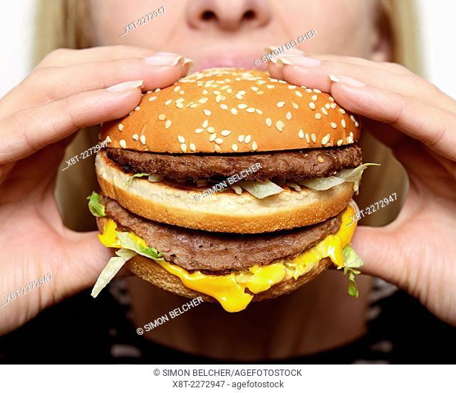 Woman Eating a Burger, Close Up