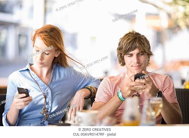 Man and woman writing sms