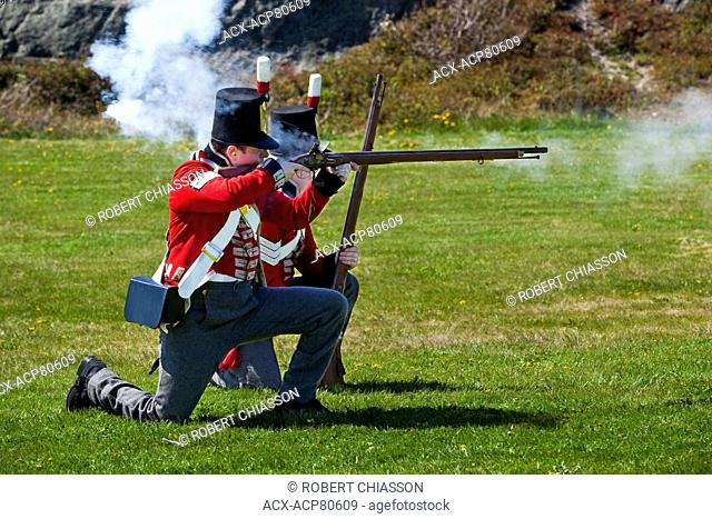 Two staff members of Signal Hill National Historic Site reenacting firing exercises while dressed in Royal Newfoundland Regiment uniforms from the 1795 period
