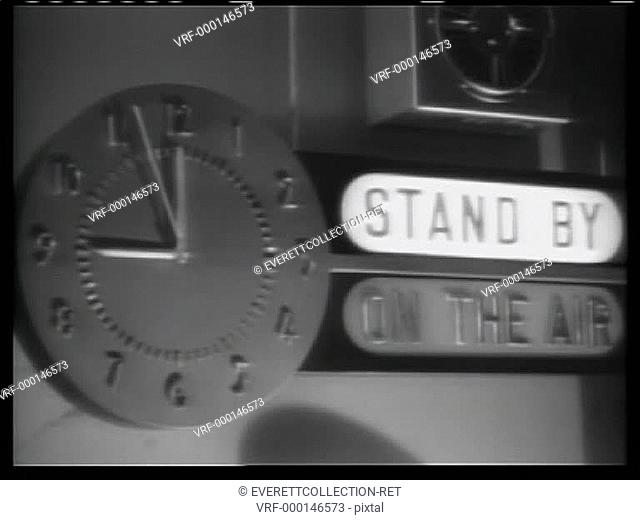 Wall Clock at 9 o'clock as On the Air sign lights up