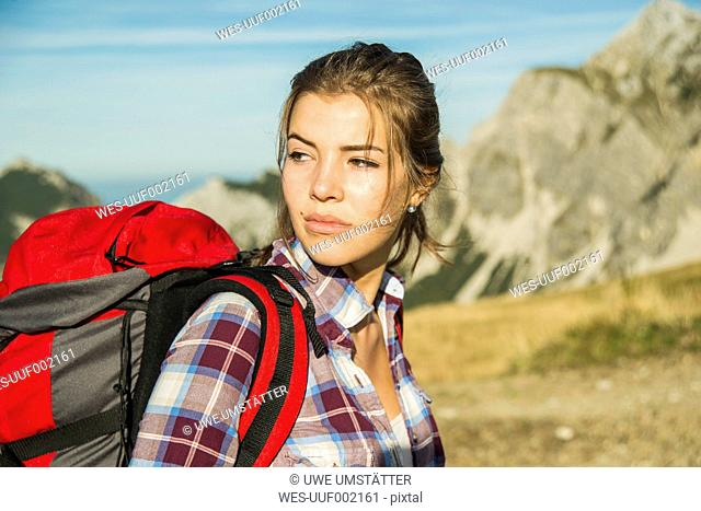 Austria, Tyrol, Tannheimer Tal, young woman on a hiking trip
