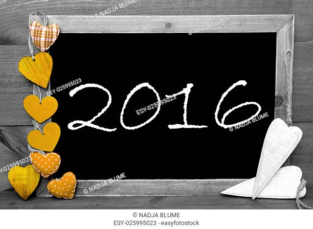 Chalkboard With 2016 For Happy New Year Greetings And Yellow Hearts. Wooden Background With Vintage, Rustic Or Retro Style