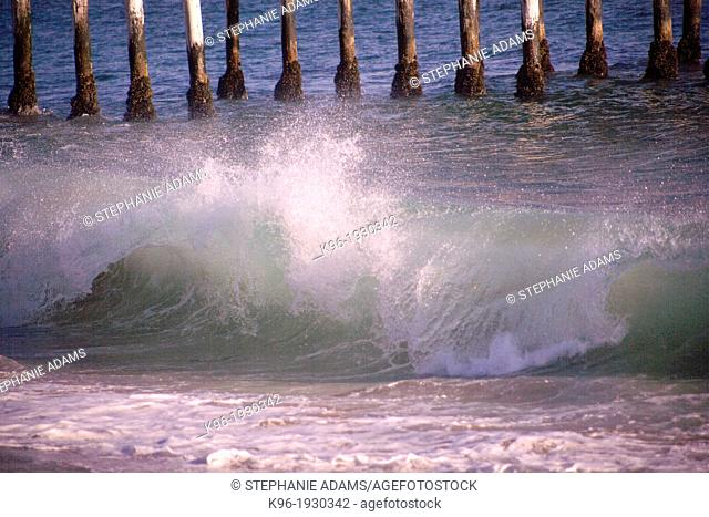 Ocean wave cresting onto the sand