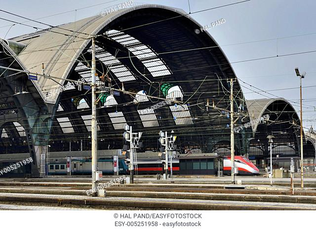 railway central station, Milan  foreshortening of train side at main railway station, a train is going out from vaulted roof