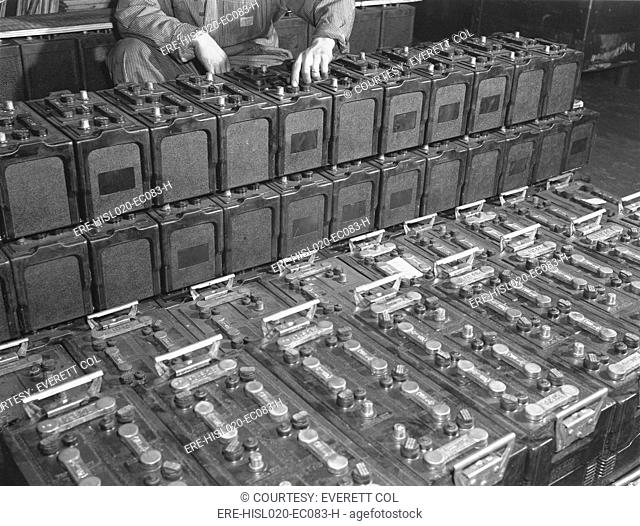 Dozens of 12 volt rechargeable automobile batteries at a the White Motor Company, Cleveland, Ohio. 1941