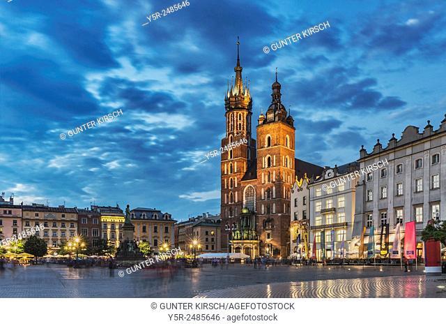 The Roman Catholic St. Marys Church at night. The symbol of Krakow is located on the Main Market Square (Rynek Glowny), Krakow, Lesser Poland, Poland, Europe