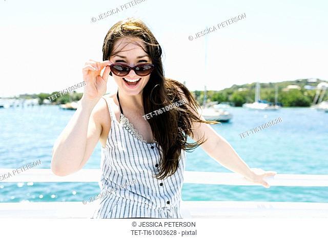 USA, Virgin Islands, Saint Thomas, Woman peeking over sunglasses