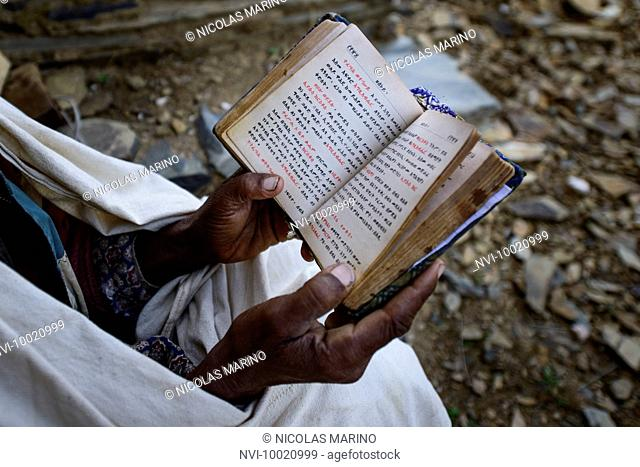 Priest of the Ethiopian orthodox church reading the bible, Tigray, Ethiopia