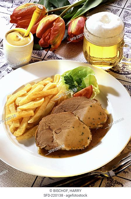 Roast pork with beer sauce, chips, mustard and beer