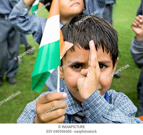 Portrait of a school girl holding the Indian flag