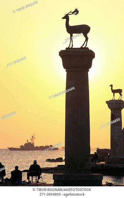 Greece, Dodecanese, Rhodes, Mandraki Harbour, statues, sunrise,