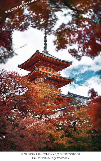 Kiyomizu-dera Sanjunoto pagoda surrounded by red leaves of Japanese maple trees. Autumn in Kiyomizu-dera Buddhist temple, Kyoto, Japan