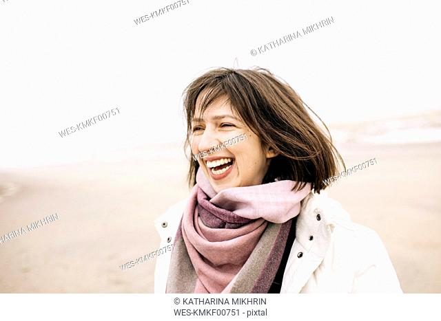 Portrait of laughing woman on the beach