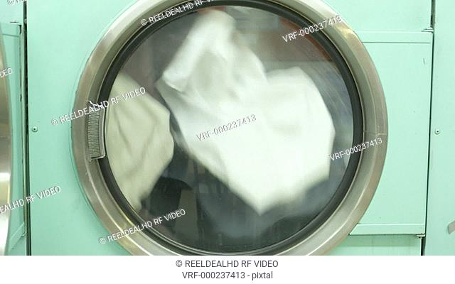 A Washing Machine spins rapdly, cleaning clothes