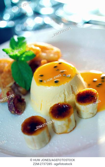 White Chocolate Ice Cream with mango sauce and caramelized banana