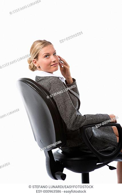 Beautiful young business woman working talking on the phone