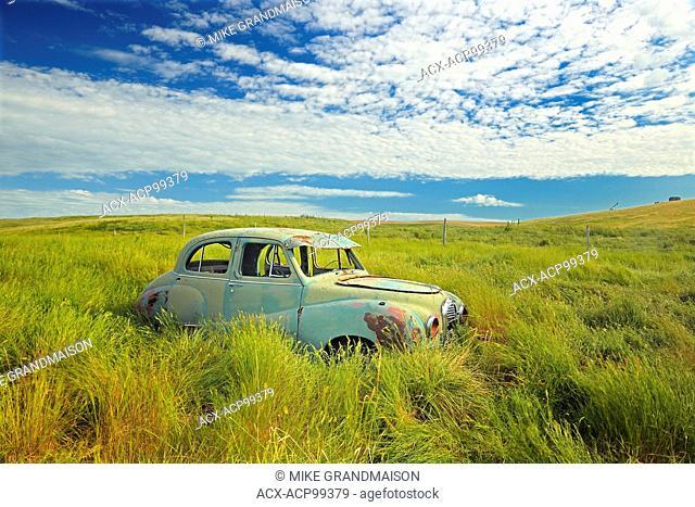 Old Austin car in field in ghost town Neidpath Saskatchewan Canada