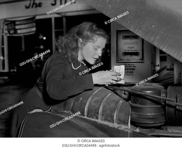 Virginia Excell, formerly a Butcher, now a Service Station Attendant as new Jobs have opened up for Women during WWII, Checking Car Engine, East Liverpool, Ohio