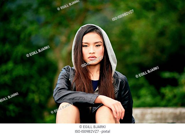 Portrait of beautiful young woman in hoody