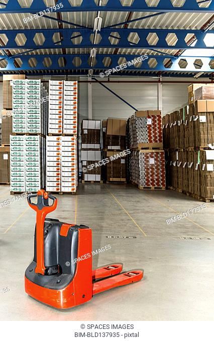 Mechanical dolly with pallets in warehouse
