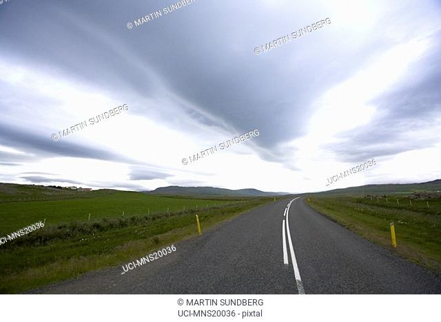 Country road with dramatic sky, Iceland