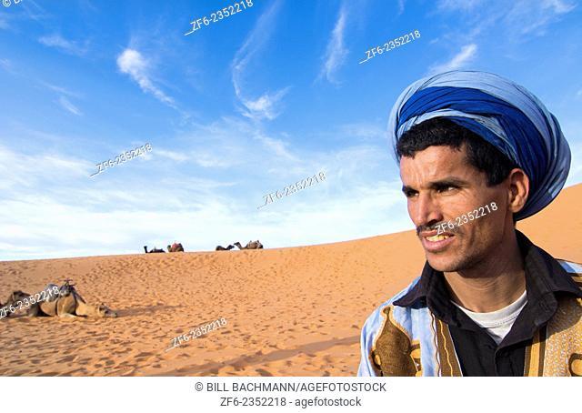 Morocco Sahara Desert sand dunes portrait of local man with turbin in Las Palmeras area