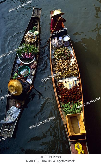 High angle view of two market vendors in a floating market, Thailand