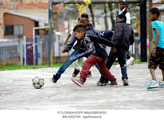 Children and teenagers playing football, Villa Javier, Bogota, Colombia