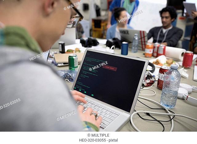 Hacker coding working hackathon at laptop
