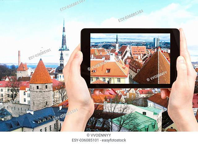 travel concept - tourist photographs Tallinn city skyline, Estonia on tablet pc