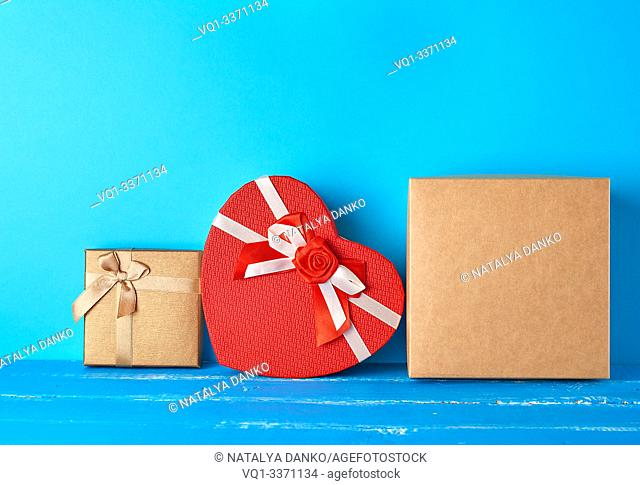 various cardboard boxes on a blue background, festive backdrop, copy space