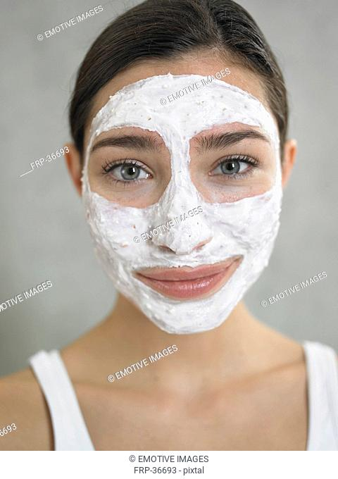 Woman with curd mask
