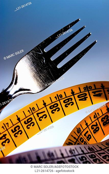 Fork and measuring tape. Concept of food and weight loss