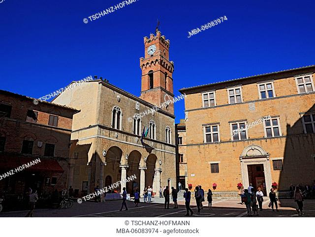 Italy, in the Old Town of Pienza, city hall, the Palazzo Communale (left). and the episcopal palace, Palazzo Borgia (on the right)