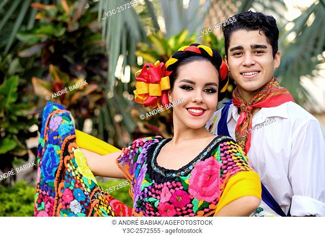 Portrait of young couple. Puerto Vallarta, Jalisco, Mexico. Xiutla Dancers - a folkloristic Mexican dance group in traditional costumes representing the culture...