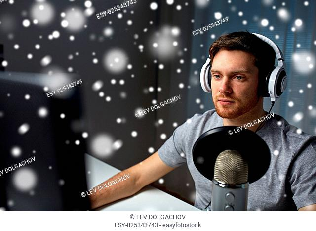 technology, gaming, entertainment, let's play and people concept - young man in headset with pc computer playing game at home and streaming playthrough or...