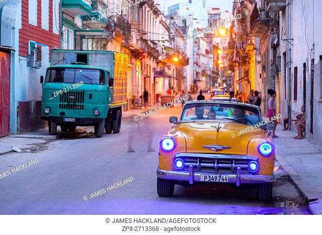 A classic American car at night in Centro Habana at dusk. Havana, Cuba