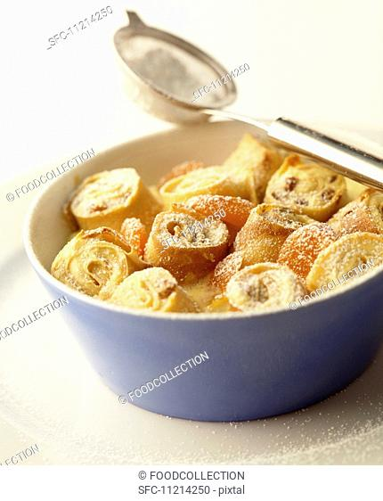 Rolled strips of pancake with quark filling, baked in the oven