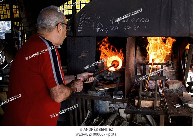 Man using a furnace in a glass factory in Mallorca