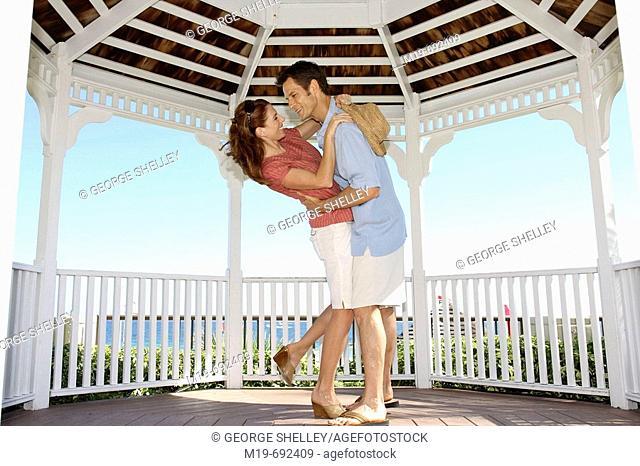 Romantic couple dancing in a Gazebo