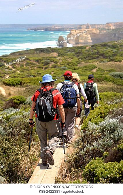 Bushwalkers at the end of the Great Ocean Walk, overlooking the Twelve Apostles. Port Campbell National Park, Victoria, Australia