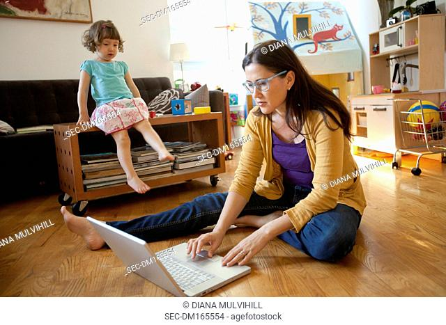Mother and daughter together in living room