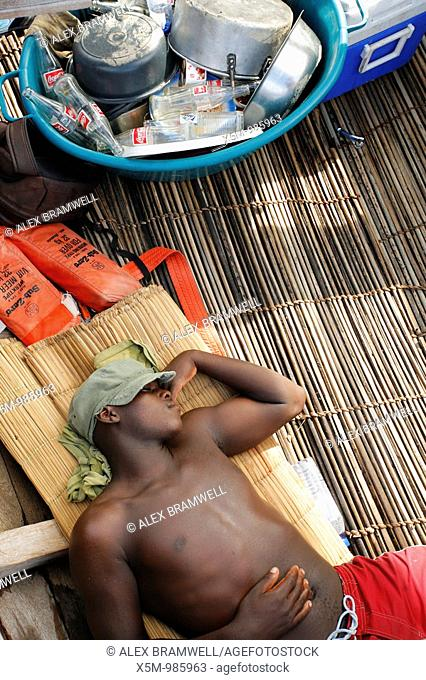 Man resting in the bottom of a dhow in Mozambique